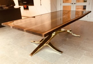 brass antler and walnut dining table